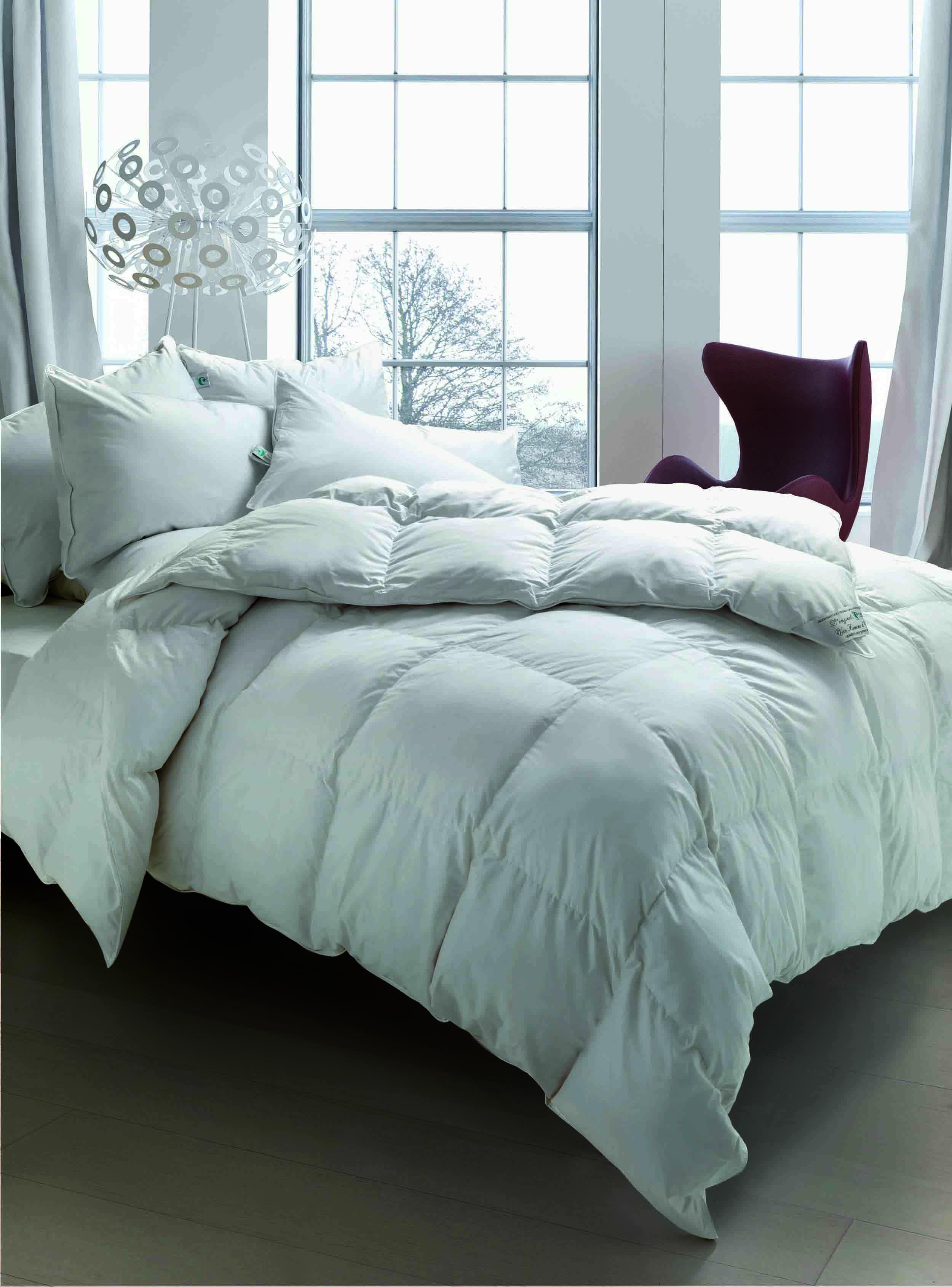Cinque buoni motivi per dormire avvolti da un piumino - Cinelli piumini letto prezzi ...